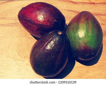 Coler Change Avocado fruits on wood