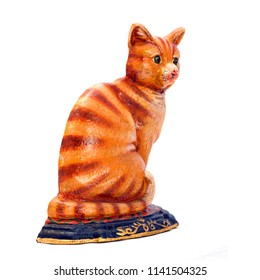Colered antique figurine  of a cat. Isolated image