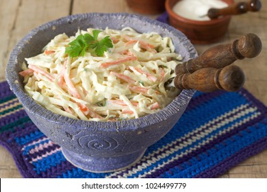 Coleslaw Salad from cabbage and carrots with dressing mayonnaise.