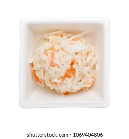 Coleslaw salad in a square bowl isolated on white background