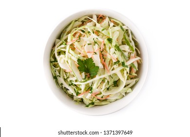 Coleslaw salad in white bowl isolated on white background. Top view