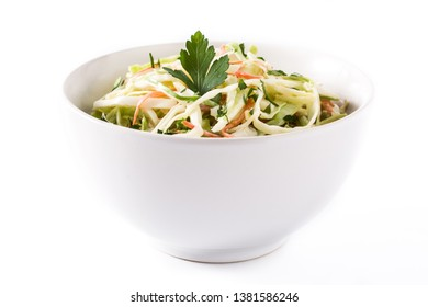 Coleslaw salad in white bowl isolated on white background.
