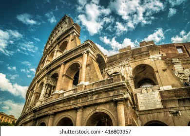 Coliseum or Colosseum in Rome, Italy. Ancient Roman Coliseum is the main tourist attractions of Rome. Coliseum is the largest amphitheatre ever built. Famous Coliseum close-up on blue sky background.
