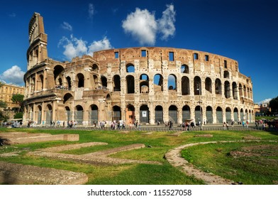 Coliseum or Colosseum in Rome, Italy. It is the main tourist attraction of Rome. Ancient Roman ruins in central Rome. Historical architecture of Rome in summer. People visit the Roma famous landmark.