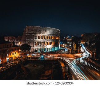 Coliseum or Flavian Amphitheatre or Colosseum (Amphitheatrum Flavium or Colosseo), Rome, Italy. Night lights, long exposure photo