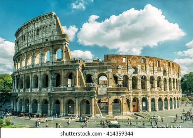 Coliseum in Rome, Italy. Ancient Roman Coliseum or Colosseum is one of the main travel destinations in Europe. Tourists visit the Coliseum in summer. Beautiful view of the famous Coliseum ruins.
