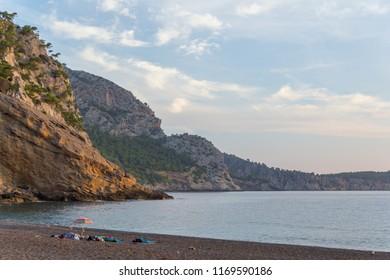 Coll Baix beach near Alcudia, Mallorca, Spain during pink pastel sunrise. Calm remote beach on Majorca, Balearic Islands.