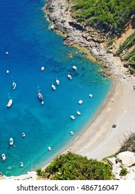 Coll Baix beach / playa, Majorca, Spain - bay with clear turquoise water - detail view from above during hiking tour
