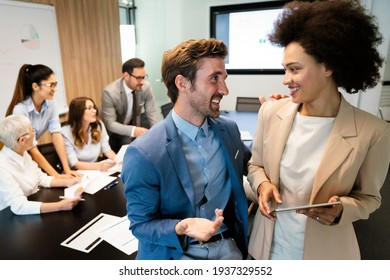 Collaboration and analysis by business people working in office