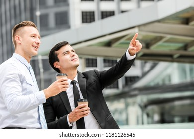 Collaboration in Business Team success. StrongTeamwork concept.Portrait of handsome caucasian confident businessmen happy with smiling face  on city background. Succesful business teamwork concept.