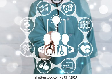 Collaboration Ideas Medicine concept. Doctor presses doctor team light bulb button on a virtual graphical user interface. Completing idea. Cooperation, Teamwork. Collaborative medical technology.