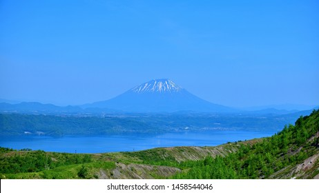 Collaboration scene of Mt. Yotei and Lake Toya seen from promenade of Mt. Usu  at Hokkaido