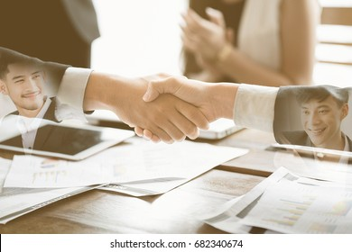 Collaboration works by co-operating with the affirmative agreement in doing business. To do project work together. Close-up of business partners