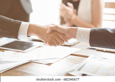 Collaboration works by co-operating with the affirmative agreement in doing business. To do project work together, Close-up of business partners
