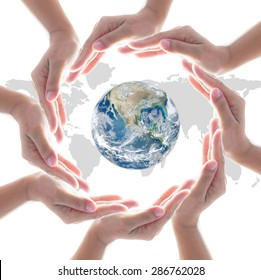 Collaborative people's hands surrounding globe world map for community empowerment concept. Elements of this image furnished by NASA