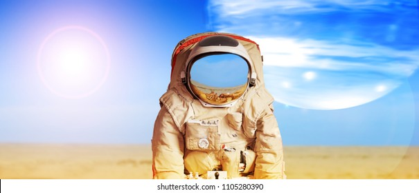 Collage with an astronaut on another planet against background of barren desert and big moon