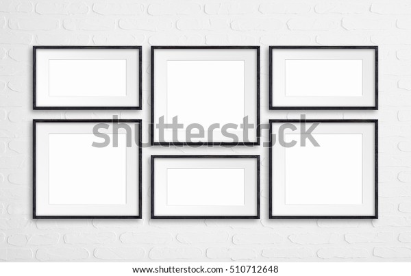 Collage of black wooden frames on white  bricks wall