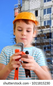 Collage with boy in plastic helmet with toy tools against background of building under construction