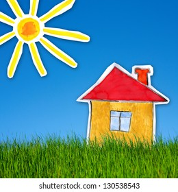 collage of childlike gouache painting of house and sun on the background of green grass  and blue sky