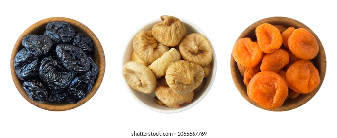 Collage of different dried fruits. Dried prunes, dried apricots, figs isolated on white background. Top view. Dried fruits isolated on a white background. Fruits with copy space for text.