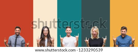 Collage of different ethnics young people over colorful stripes isolated background shouting with crazy expression doing rock symbol with hands up. Music star. Heavy concept.