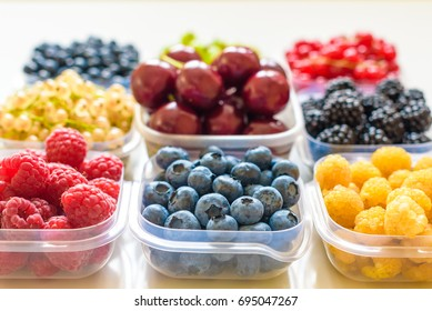 Collage of different fruits and berries isolated on white.  Collection of fruits and berries in a bowl. Top view.