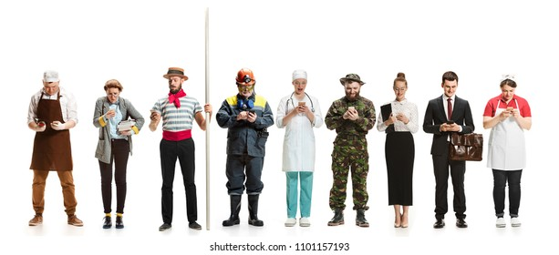 Collage of different professions. Group of men, women in uniform standing at studio with phone isolated on white. Full length of people with different occupations. Buisiness, professional, labor day