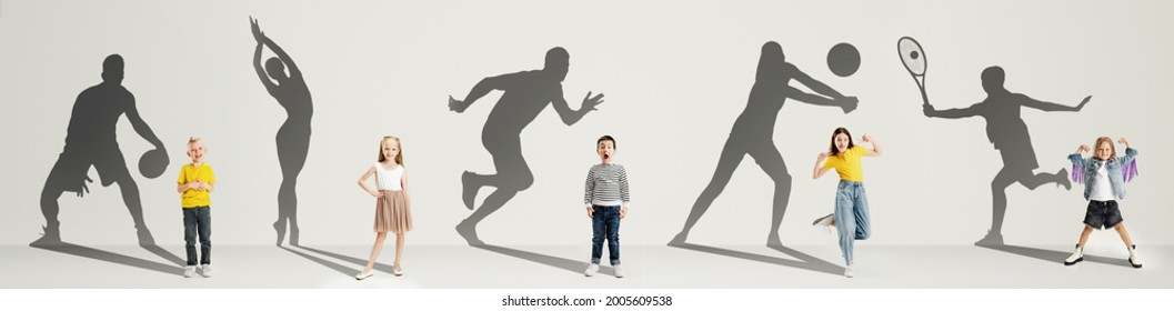 Collage. Dreams about big and famous future. Conceptual image with little boys and girls and shadows of professional sportsmen on gray background. Childhood, dreams, imagination, education concept.