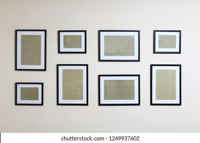 Collage from empty different sizes frames on the wall