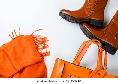 Collage of Feminine  clothing and accessories.shoes, scarf, gloves, bag and glasses  for autumn day in yellow and orange color on white background.