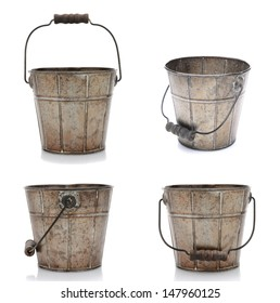 Collage of four views of an old fashioned metal bucket. Isolated on white with reflection.