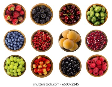 Collage of fruits and berries. Blueberries, blackberries, cherries, grapes, strawberries, currants, raspberries, bilberries, gooseberries, pomegranate and apricots. Top view.