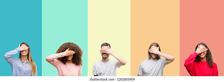 Collage of group of young people over colorful vintage isolated background smiling and laughing with hand on face covering eyes for surprise. Blind concept.