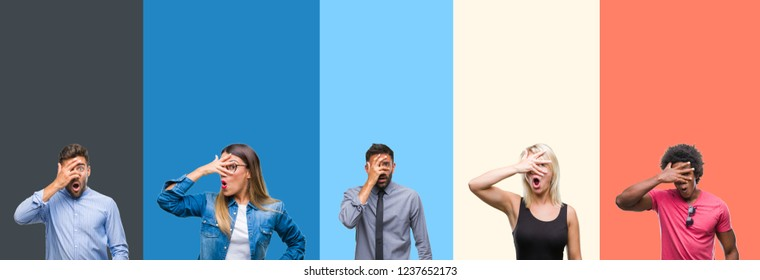 Collage of group of young people over colorful vintage isolated background peeking in shock covering face and eyes with hand, looking through fingers with embarrassed expression.
