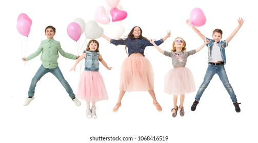 Collage happy group of kids  with balloons  jumping on a white background. Children's funny birthday party.