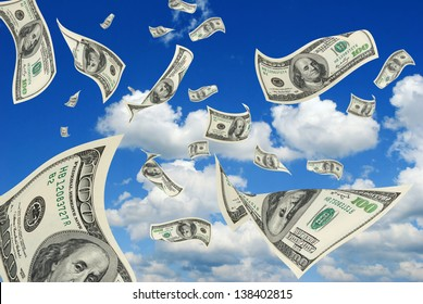 Collage - hundred-dollar bills floating in the sky.