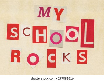 Collage made from newspaper and magazine clippings saying 'My School Rocks' on old stained paper background