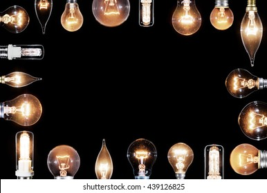 Collage of many Edison lamps glowing over black background, copyspace frame