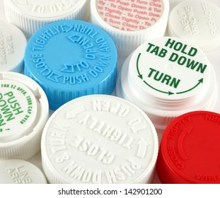 Collage of medicine bottle safety caps on a white background
