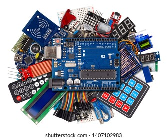 collage of microcontroller board display sensor button switches cable wire accessories and equipment isolated on white electronics concept background