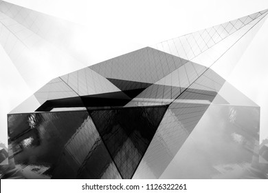 Collage of modern architecture fragments with angular structure. Abstract black and white architectural or industrial background with geometric shapes.
