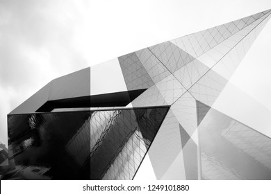 Collage of modern architecture fragments with angular structure. Transparent and matte wall panels. Abstract black and white architectural background with geometric shapes.