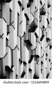 Collage photo of building exterior fragment with convex and concave elements. Architectural surfaces in black and white. Realistic though unreal modern architecture with angular geometric structure.