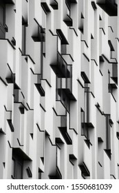 Collage photo of convex and concave elements of building exterior fragment. Architectural graphics in black and white. Realistic though unreal modern architecture with angular geometric structure.