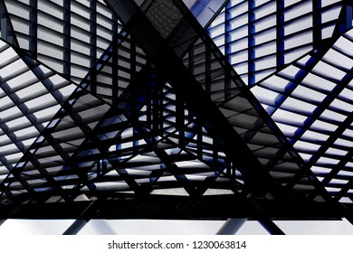 Collage photo of office building exterior fragment featuring roof with louvered and grid structures. Abstract image on the subject of modern architecture, construction industry or technology.