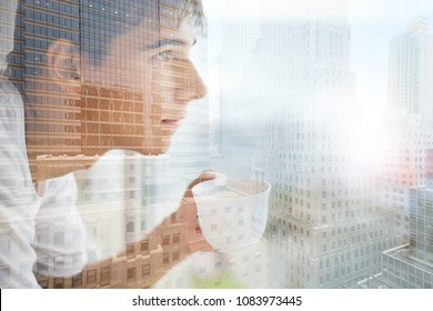 Collage with reflection of young man with cup of coffee in window on background of cityscape