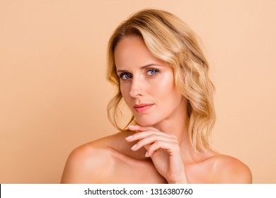 Collagen anti-age concept. Close-up portrait of nice attractive adorable wavy-haired lady with flawless perfect smooth shine fresh clean clear skin touching chin isolated over beige pastel background