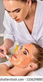 Collagen face mask. Facial skin treatment. Face of woman receiving cosmetic procedure in beauty salon close up number one isolated. Summer discounts for visiting spa salon.