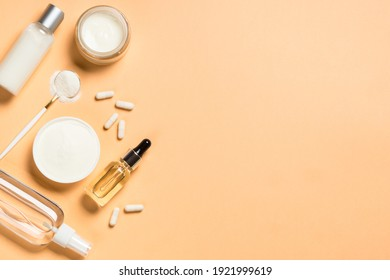 Collagen product. Anti-age cosmetic. Collagen powder, pills, cream with collagen, serum and tonic. Healthcare, skincare product. Top view with copy space.