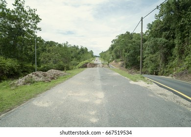 Collapsed Asphalt Road Cracked and Broken.